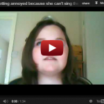 Girl Getting Annoyed Because She Can't Sing The Right Notes